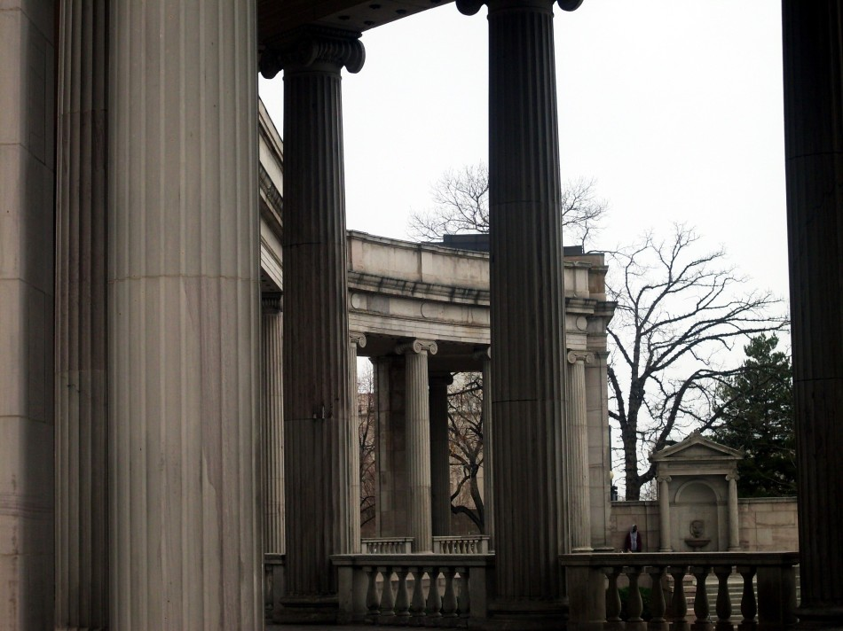 columns with hooded figure